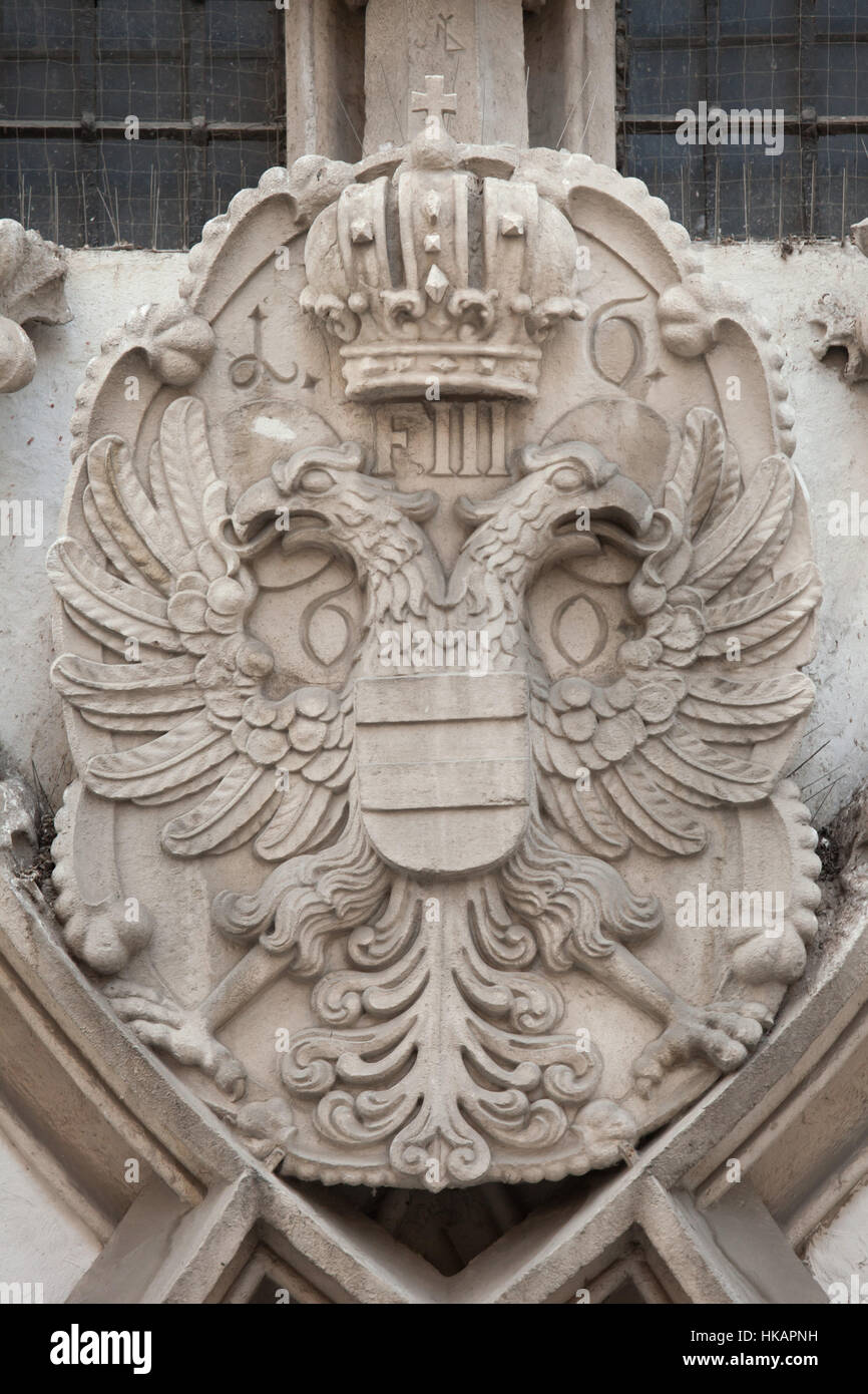 Coat of arms of the Austrian Empire combined with the coat of arms of Brno. Detail of the Gothic portal of the Old - Stock Image