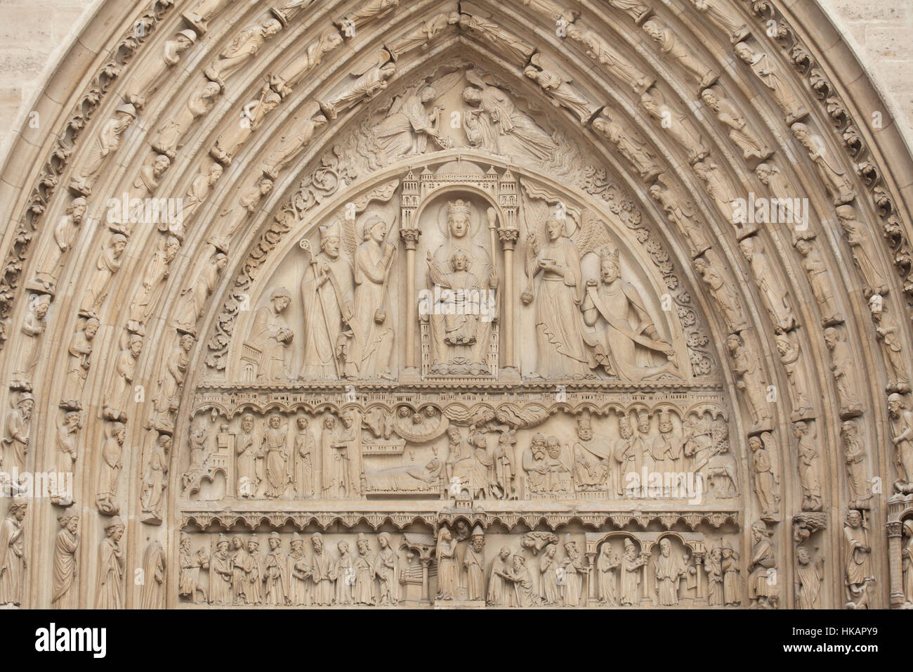 Neo-Gothic tympanum of Saint Anne's portal on the main facade of the Notre-Dame Cathedral (Notre-Dame de Paris) Stock Photo