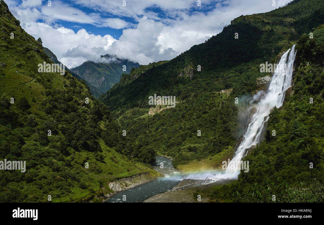 Waterfalls flow into the Kameng river in a deep valley surrounded by mountains of the Himalayas in Arunachal Pradesh, - Stock Image