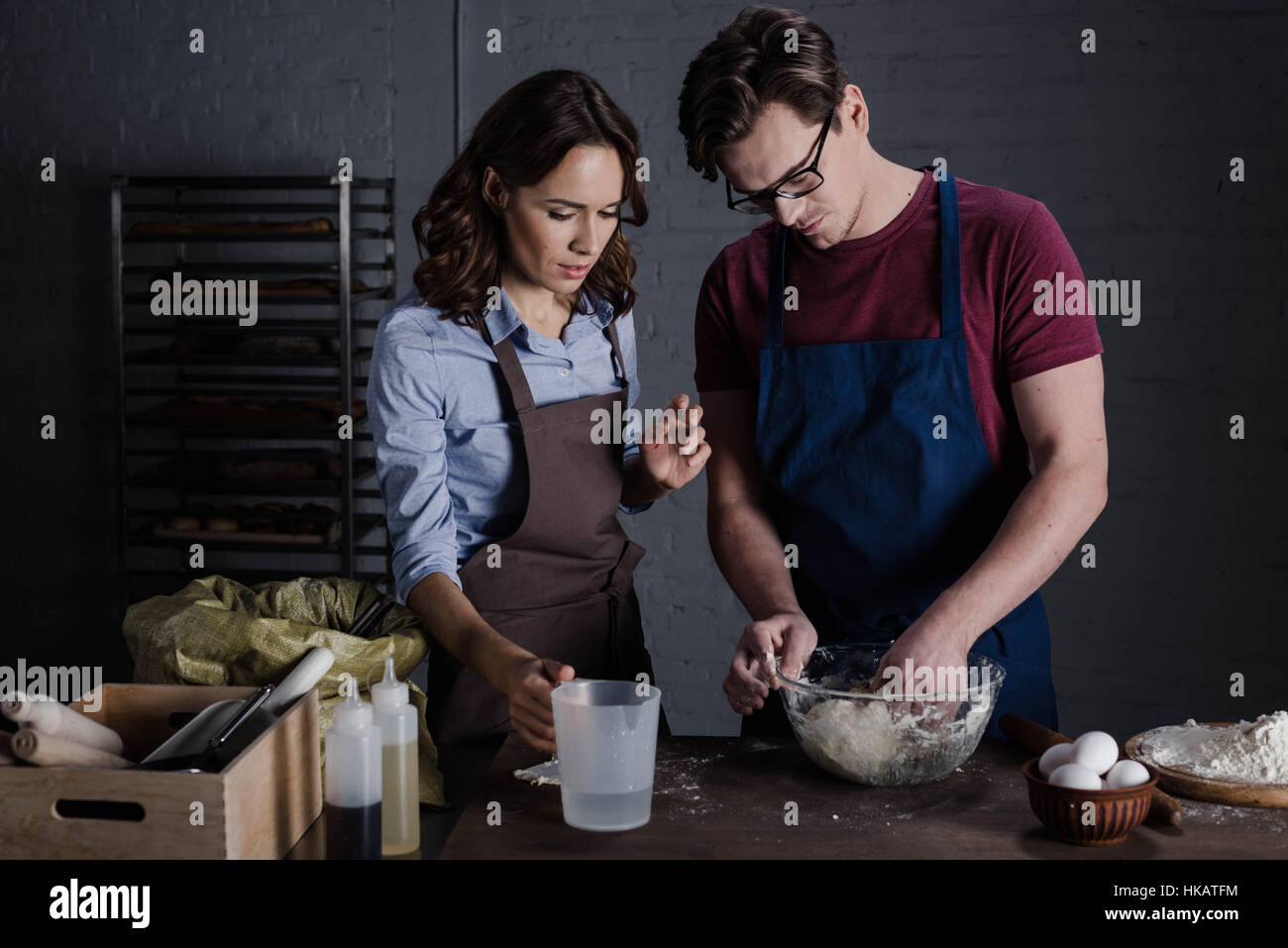 Bakers discussing ingredients - Stock Image