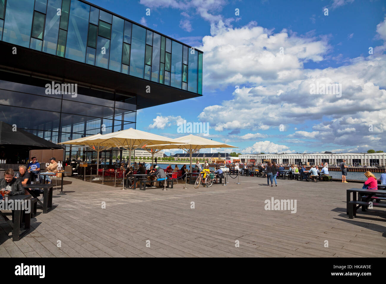 Outdoor cafe at the Royal Playhouse in the inner harbour of Copenhagen. View to Papirøen, the Paper Island, - Stock Image