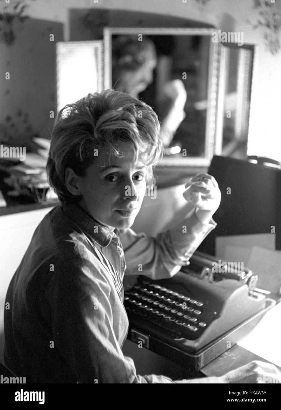 Caroline Benn (Caroline Middleton DeCamp), wife of Tony Benn, shown here at home with a portable typewriter serving - Stock Image