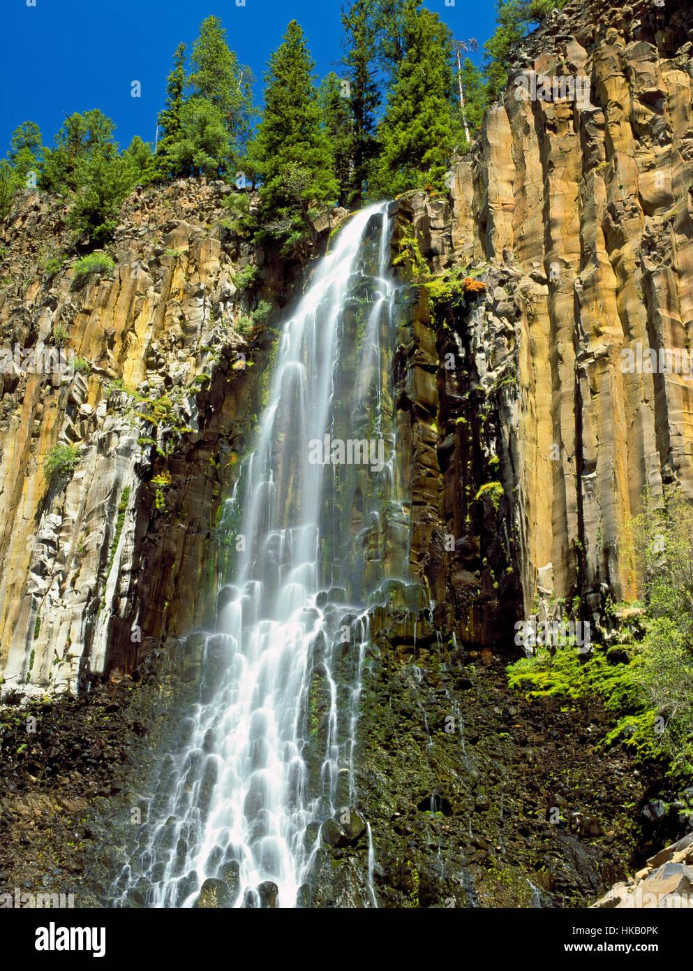 palisade falls spilling over columnar basalt in the east fork hyalite creek basin near bozeman, montana - Stock Image