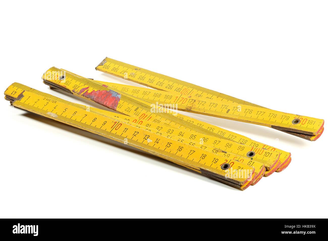 used yardstick isolated on white background - Stock Image