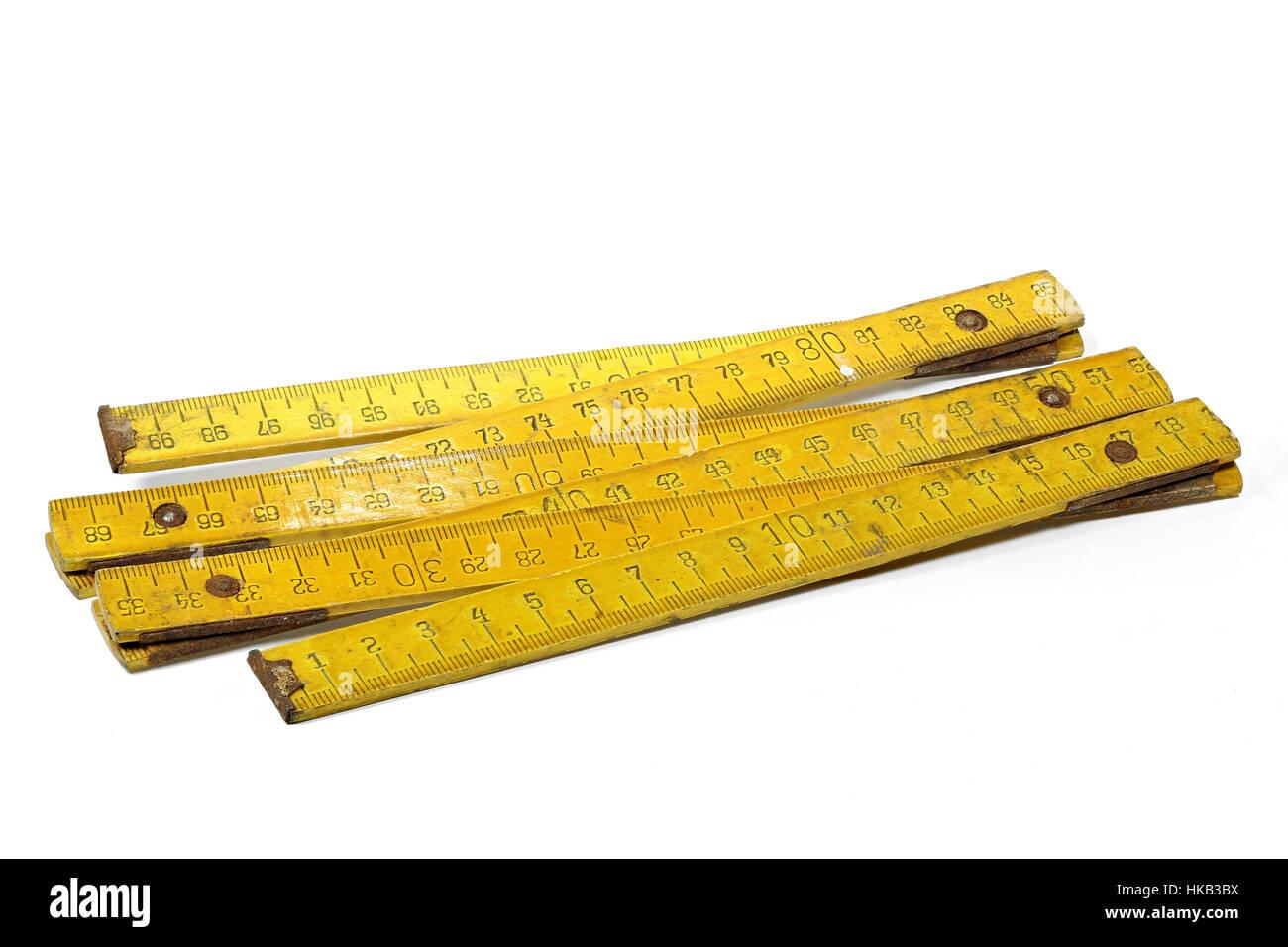 vintage 1 meter yardstick isolated on white background - Stock Image