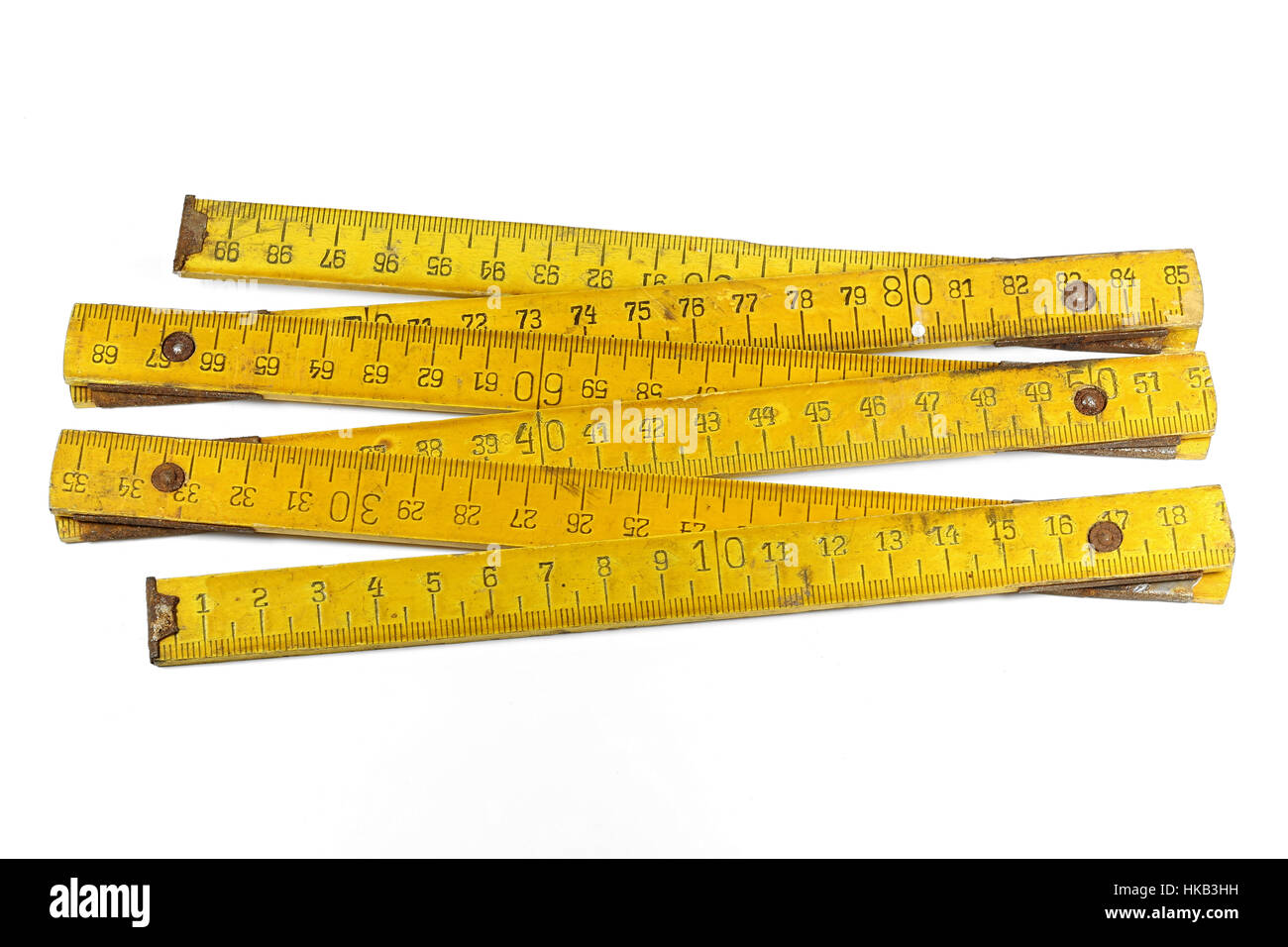 vintage 1 meter yardstick isolated on white background - Stock Image