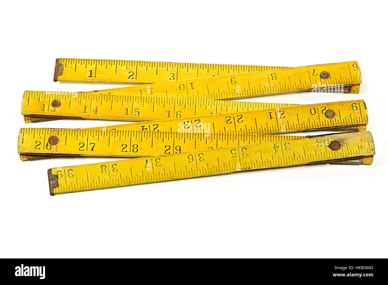 vintage 1 meter yardstick (inch unit) isolated on white background - Stock Image