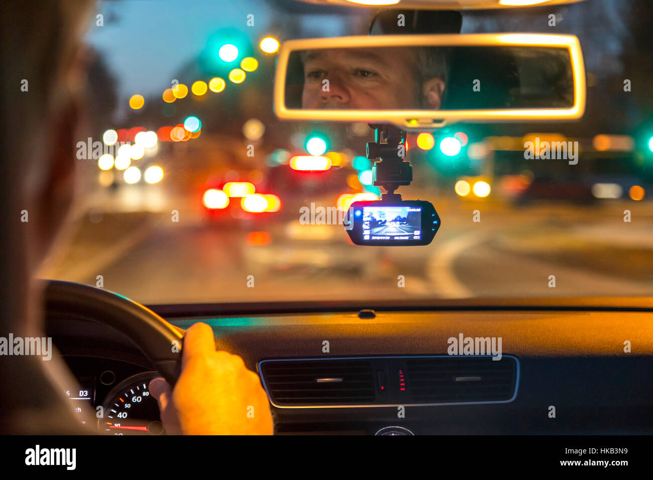 Dashcam in a passenger car, video camera on the windshield, permanently records the traffic in front of the vehicle, - Stock Image