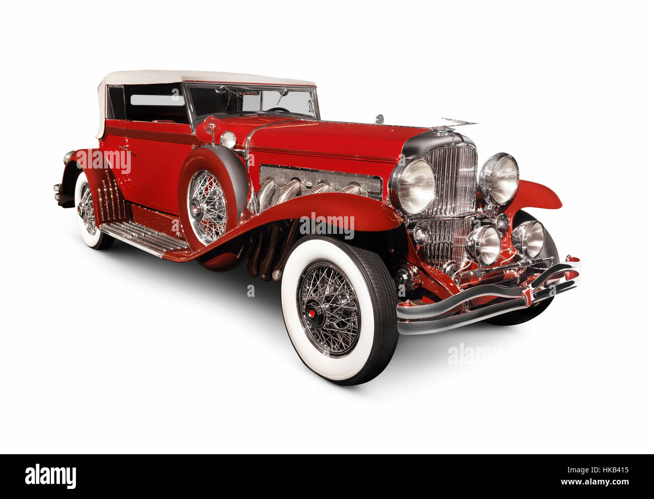 Red 1930 Duesenberg Model SJ Convertible Victoria by Rollston luxury classic vintage car isolated on white background - Stock Image