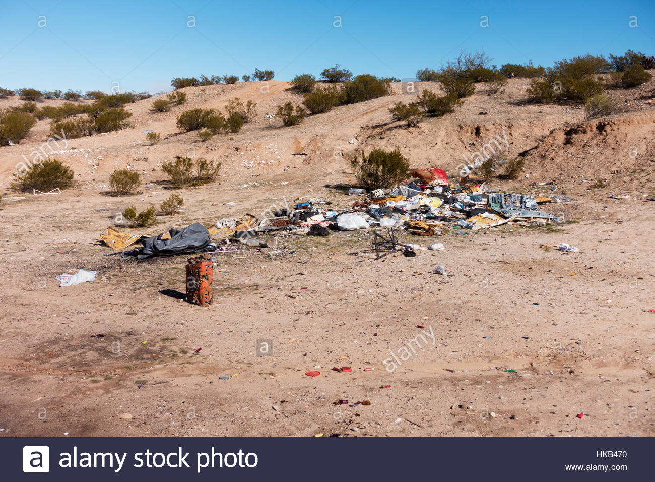 Trash illegal dumping in desert Arizona - Stock Image