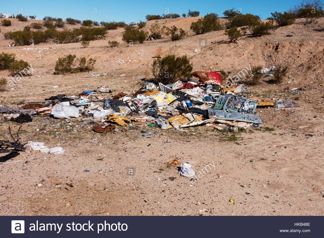 Trash illegal dumping in desert Arizona - Stock Image