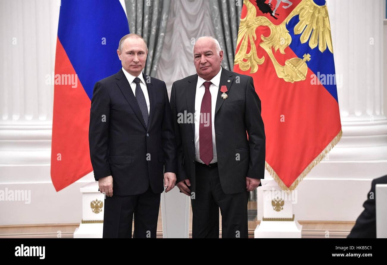Moscow, Russia. 26th Jan, 2017. Russian President Vladimir Putin stands with Mikhail Davydov, director of the N.N. - Stock Image