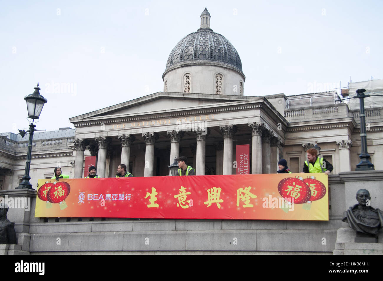 27th january 2017 workers hang a large banner in trafalgar square in preparation for the chinese new year of the rooster celebrations credit amer