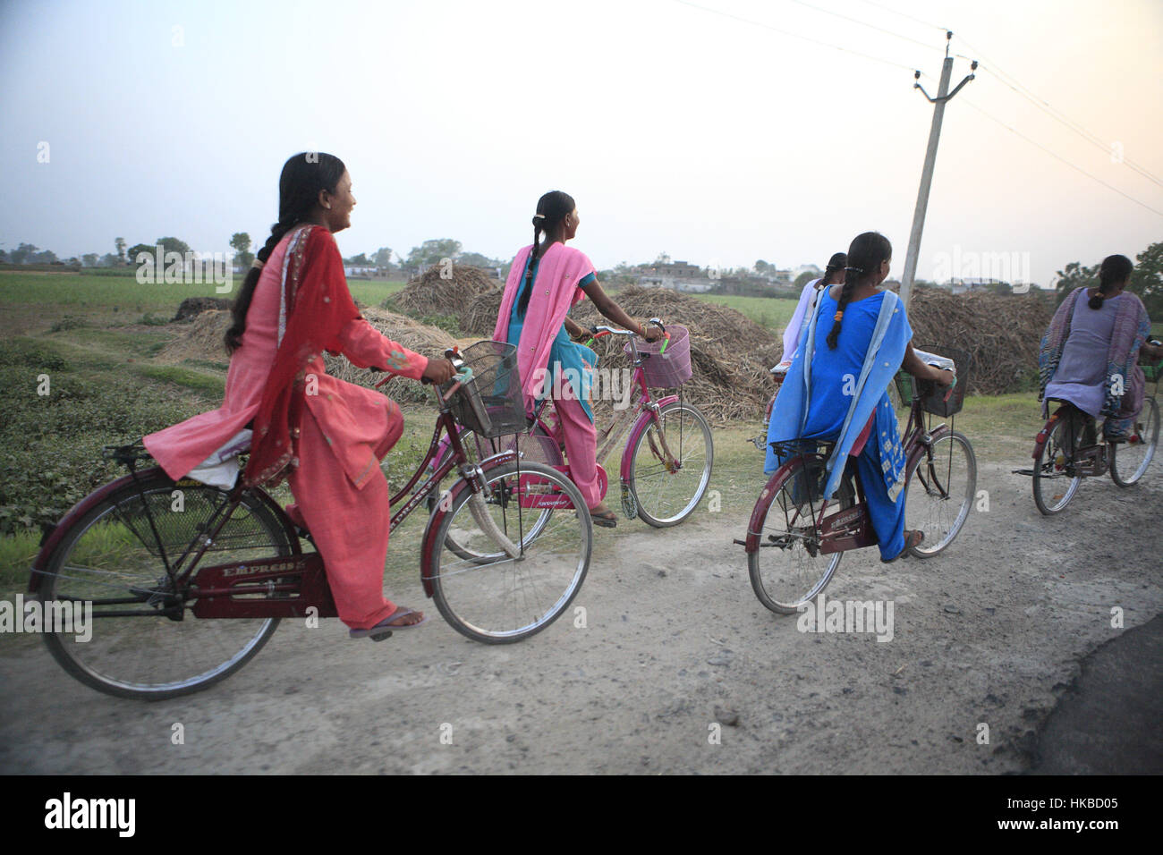 Patna, Bihar, India. 28th Apr, 2010. 28 April 2010 - Patna - INDIA.Girls ride bicycle as they return from School.Traditionally - Stock Image