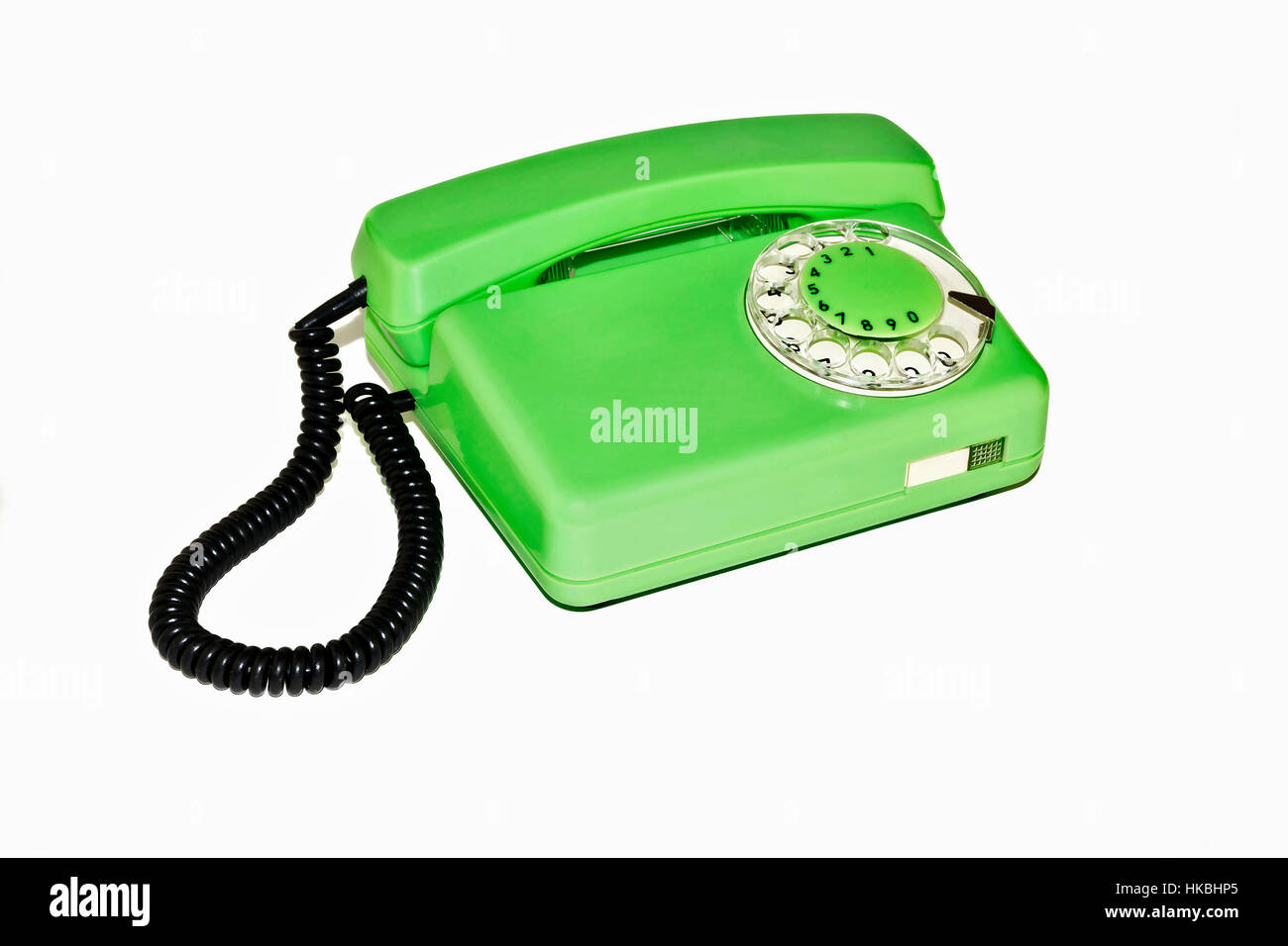 On a white background is an old telephone with a rotary dialer - Stock Image
