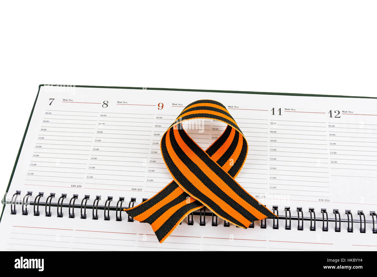 In an open diary sheet is St. George's ribbon in a bow Stock Photo