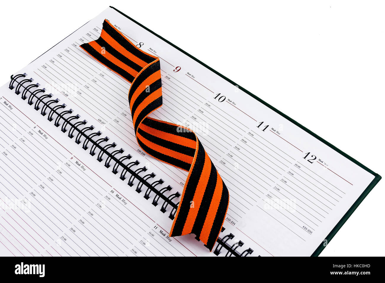 In an open diary sheet is St. George's ribbon twisted spiral - Stock Image