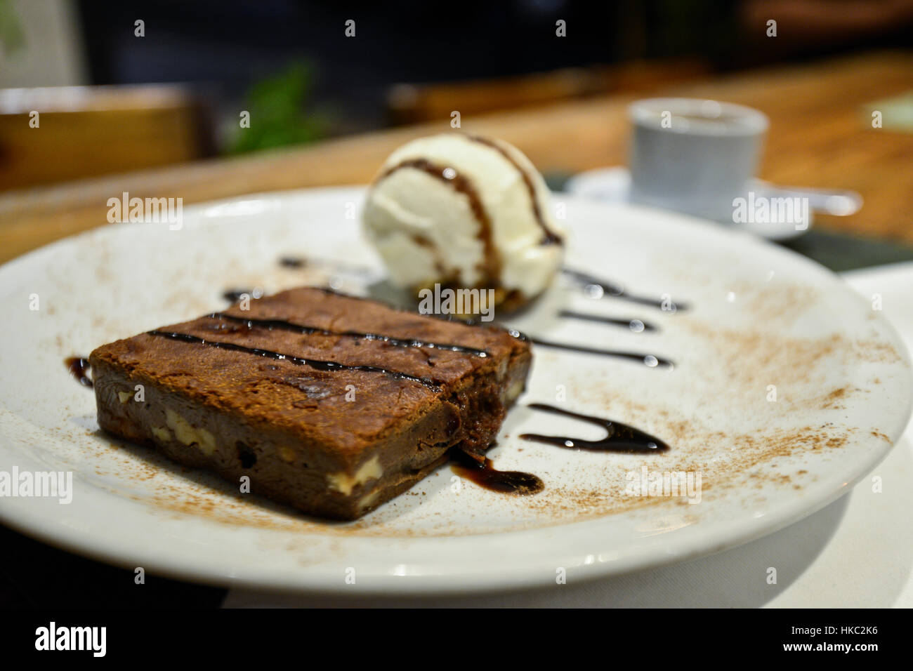 Brownie with vanilla ice cream and chocolate syrup - Stock Image