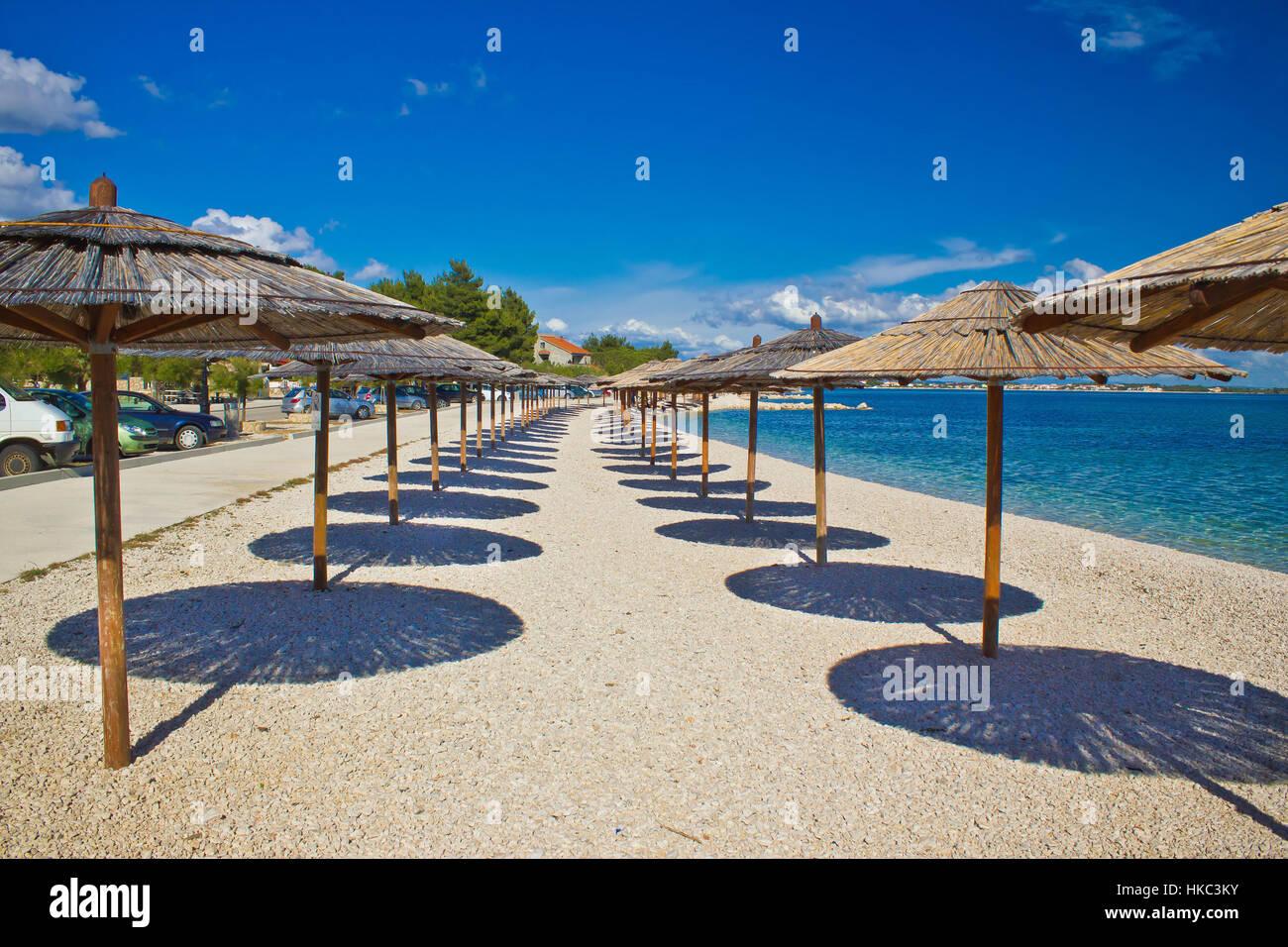 Island of Vir beach umbrellas, Dalmatia, croatia - Stock Image