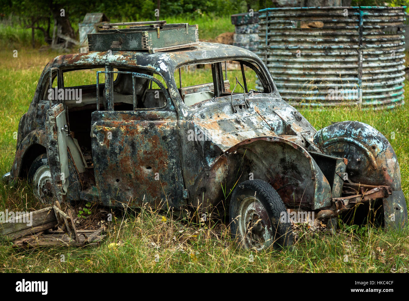 Old crashed cars. Old rusty and crashed military cars left in the ...