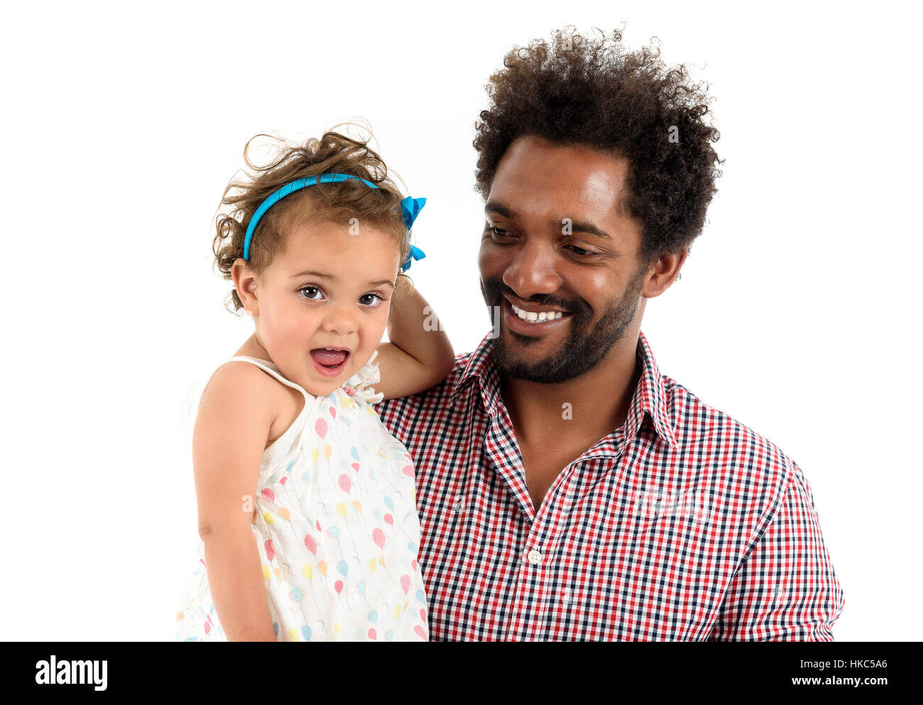African American father and mulatto daughter together isolated on white background. Happy single parent. Man is - Stock Image