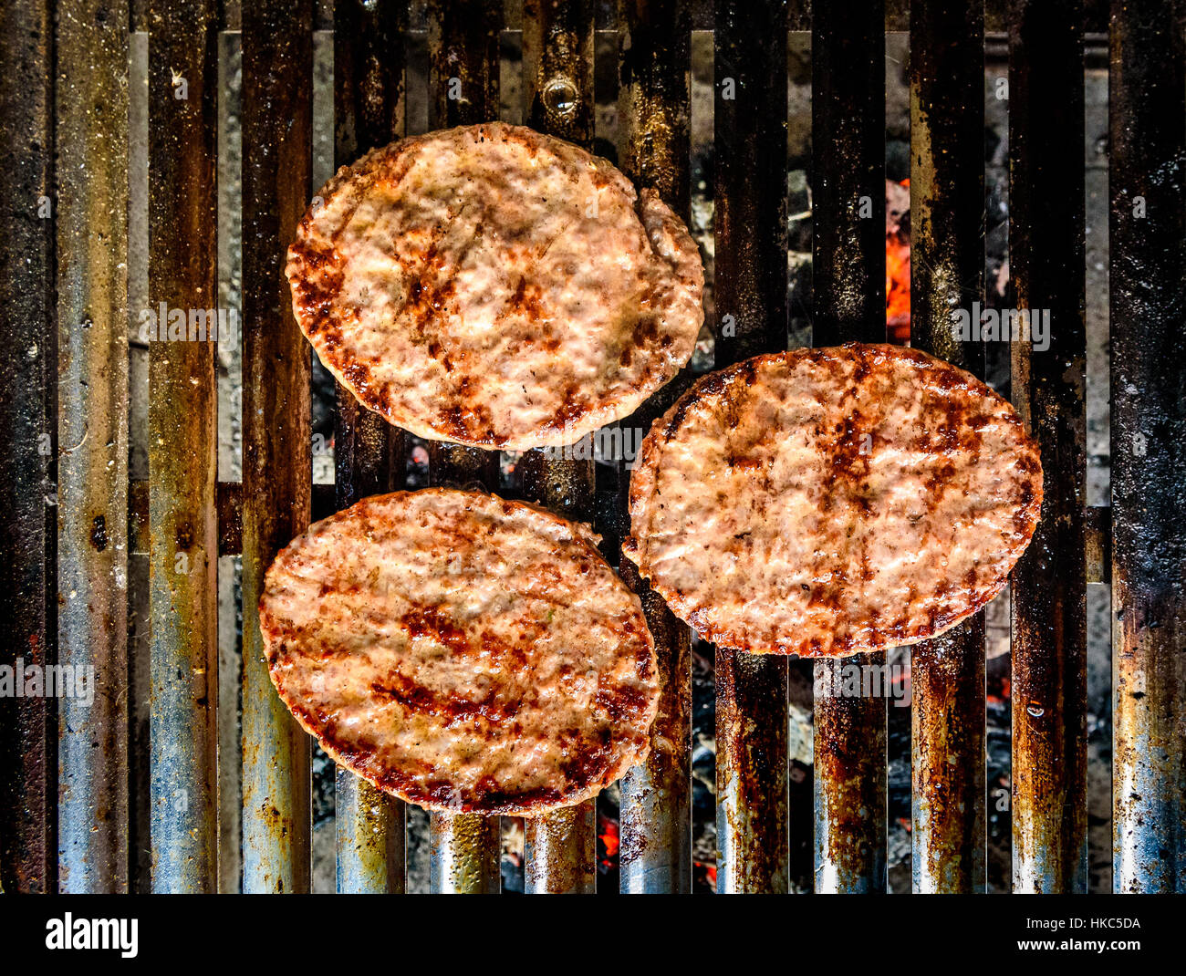 Grilling Burgers On Barbecue Bbq Grill On Hot Charcoal Homemade Stock Photo Alamy
