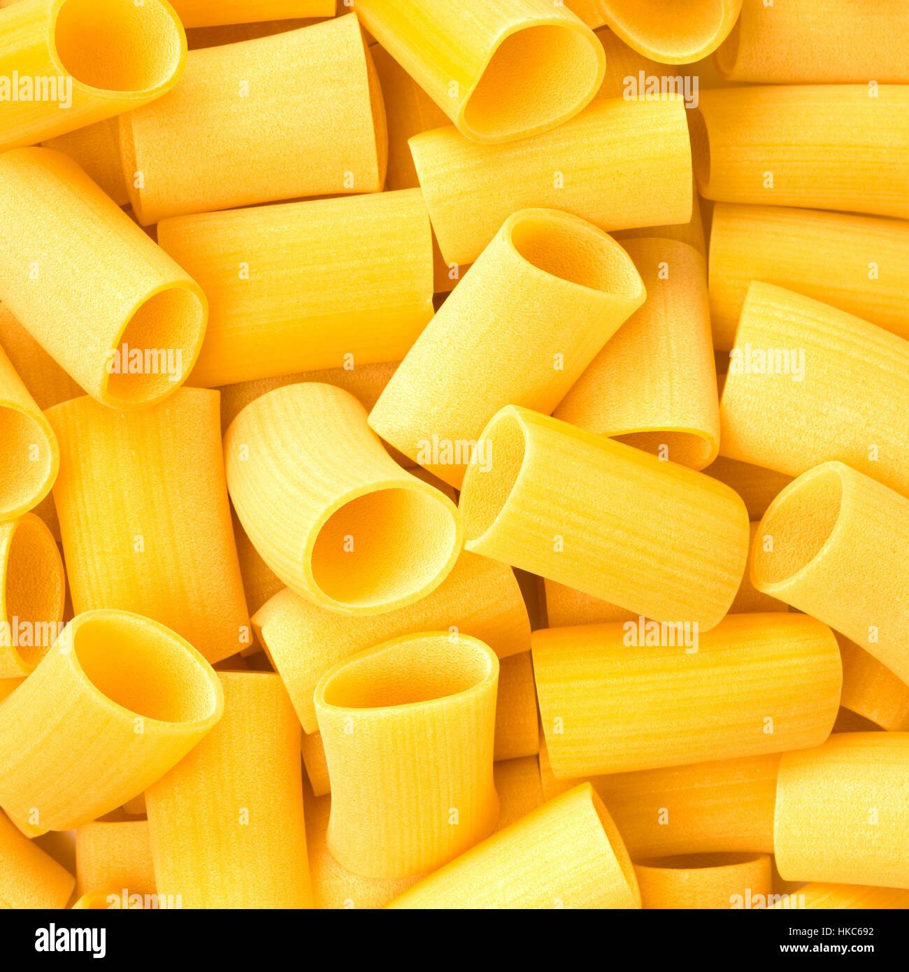 Italian Paccheri Macaroni Pasta raw food background or texture close up - Stock Image