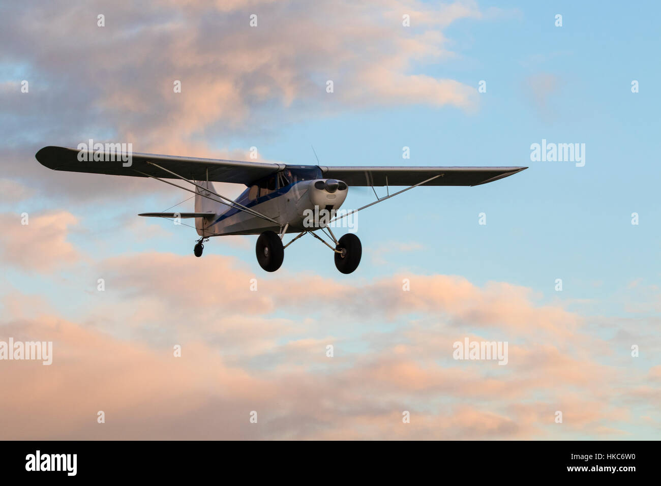 Airplane flying at the air show during twilight - Stock Image