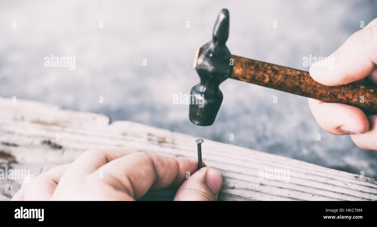 Hammer and nail - Stock Image
