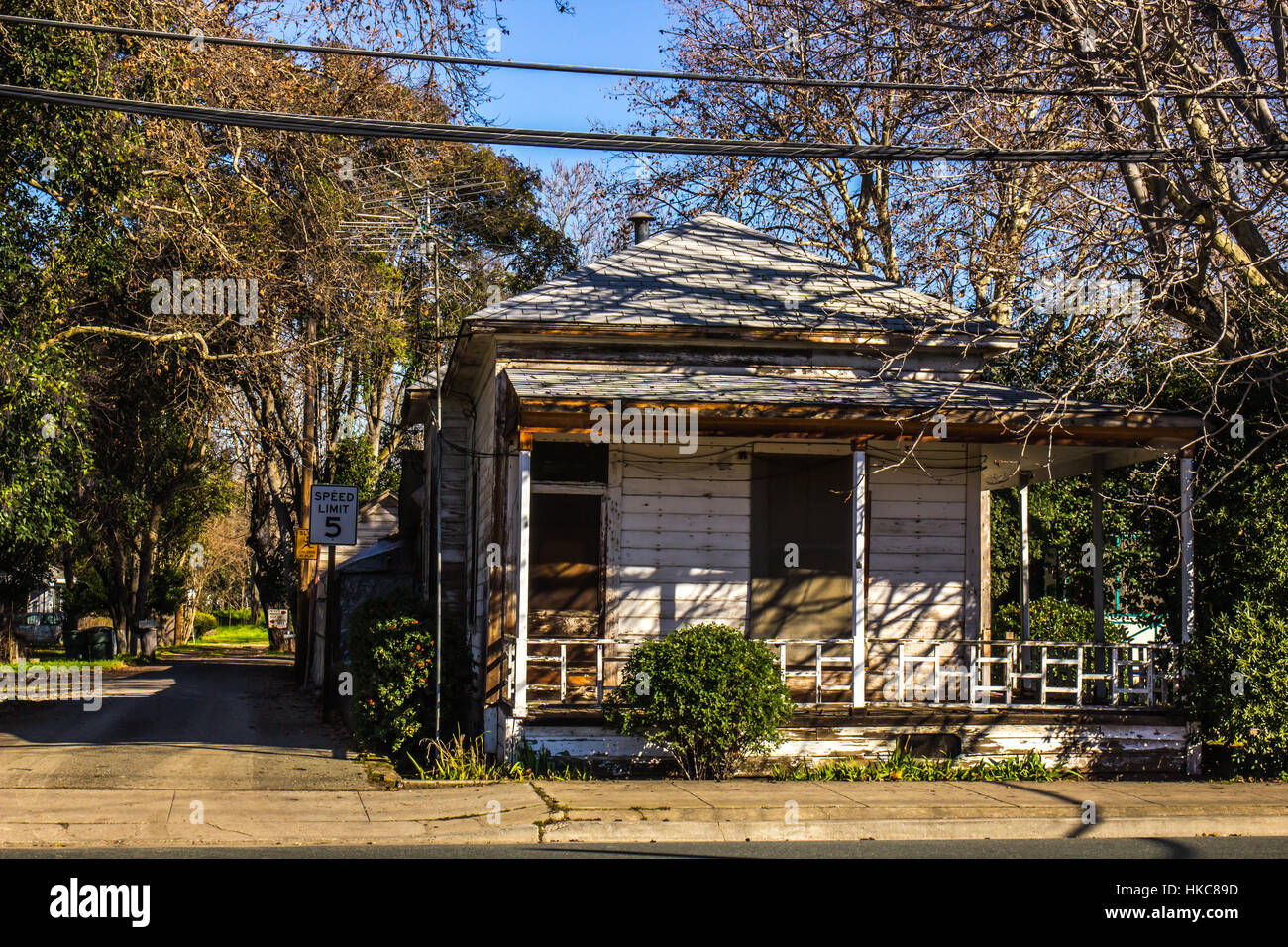 Old Boarded Up House In Disrepair - Stock Image