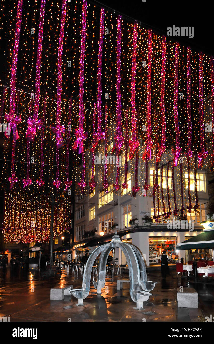 London street Christmas decorations lights St Christophers Place West End christmas shopping night scene in eating - Stock Image