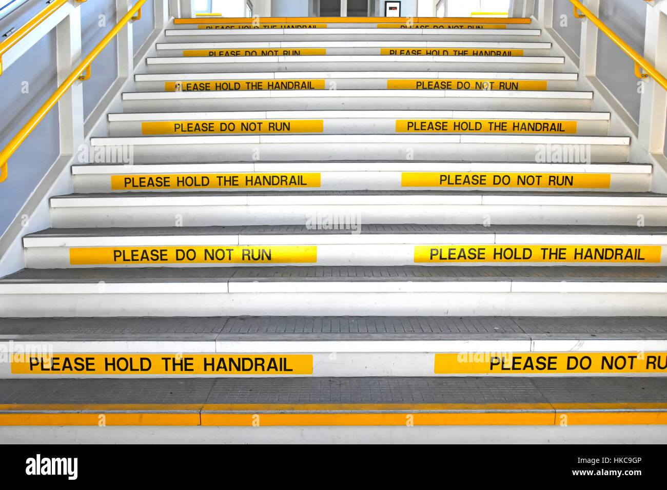 Exceptionnel Health U0026 Safety Yellow Repeat Visible Warning Signs On Risers Of Wide  Public Staircase Railway Station Platform Bans Running But Hold Handrail UK