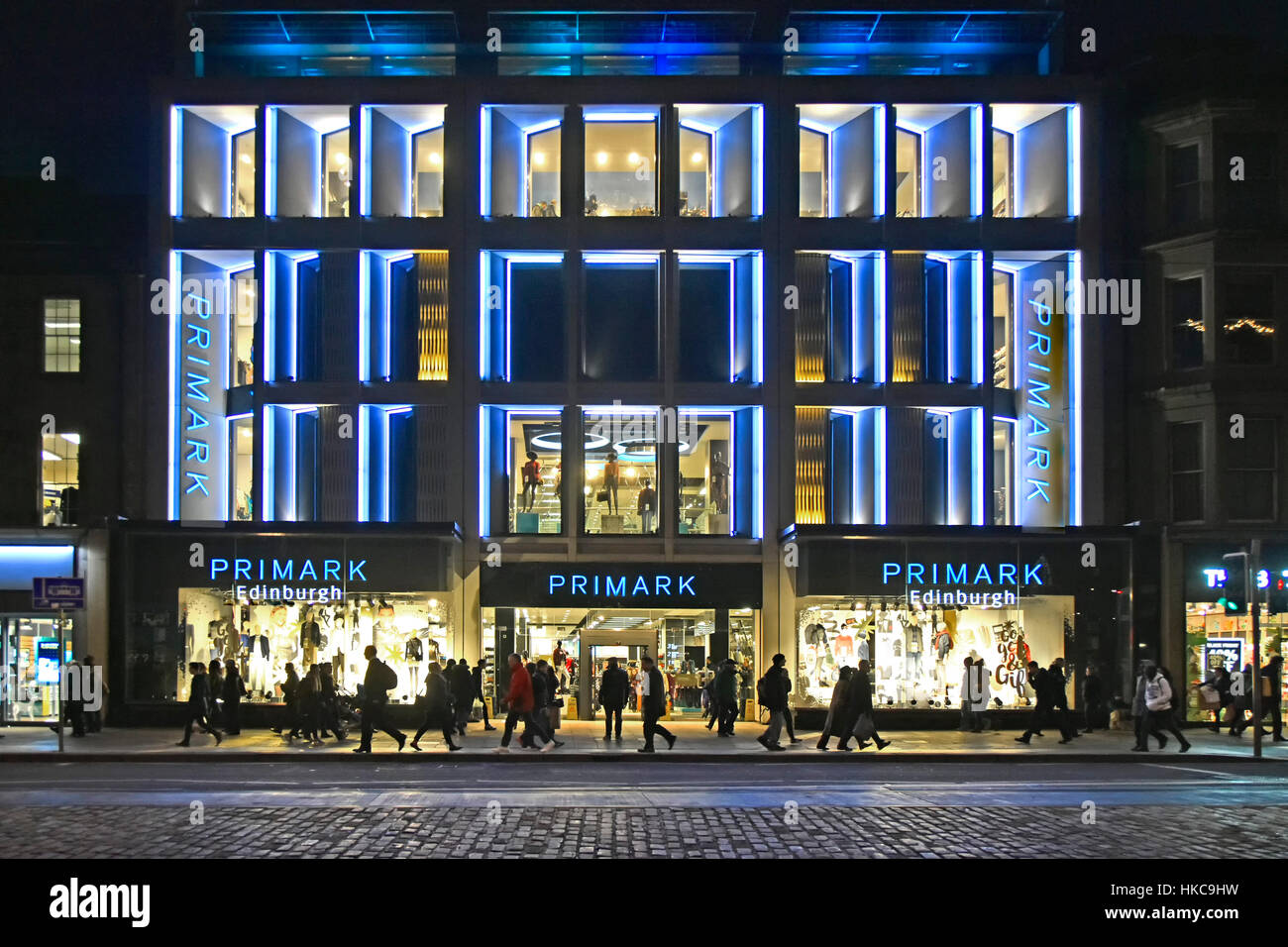 Primark retail shop Edinburgh Scotland uk city at night winter evening shopping on Princes Street (a subsidiary - Stock Image
