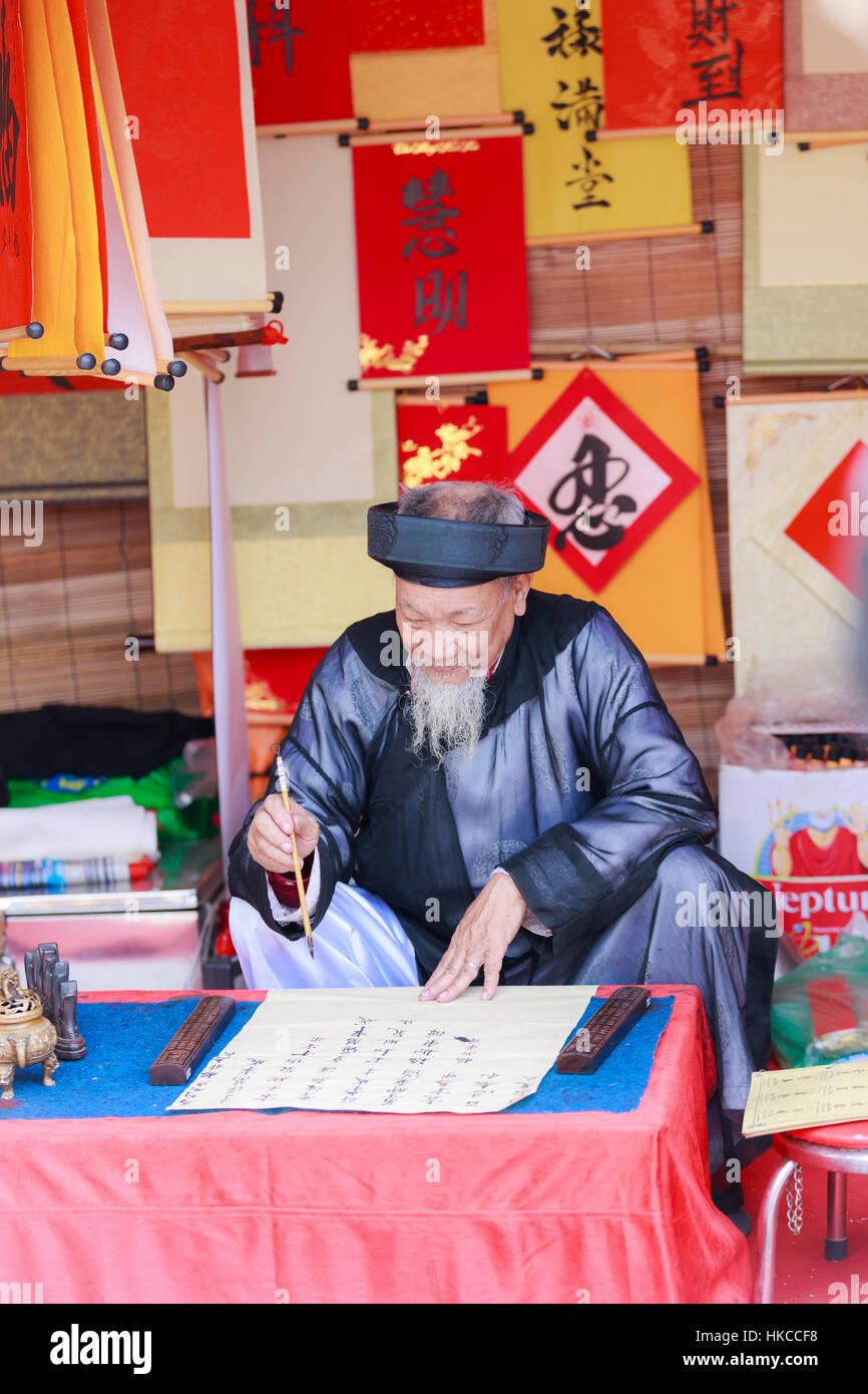 A scholar writes Chinese calligraphy characters at Temple of Literature on January 26,2017 - Stock Image