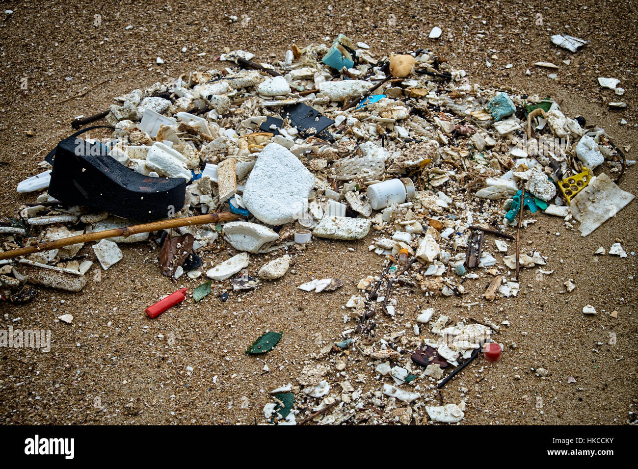 HONG KONG - JULY 18: After a storm, a mix of polystyrene, PET and plastic artifacts litter the shores of Hung Shing - Stock Image