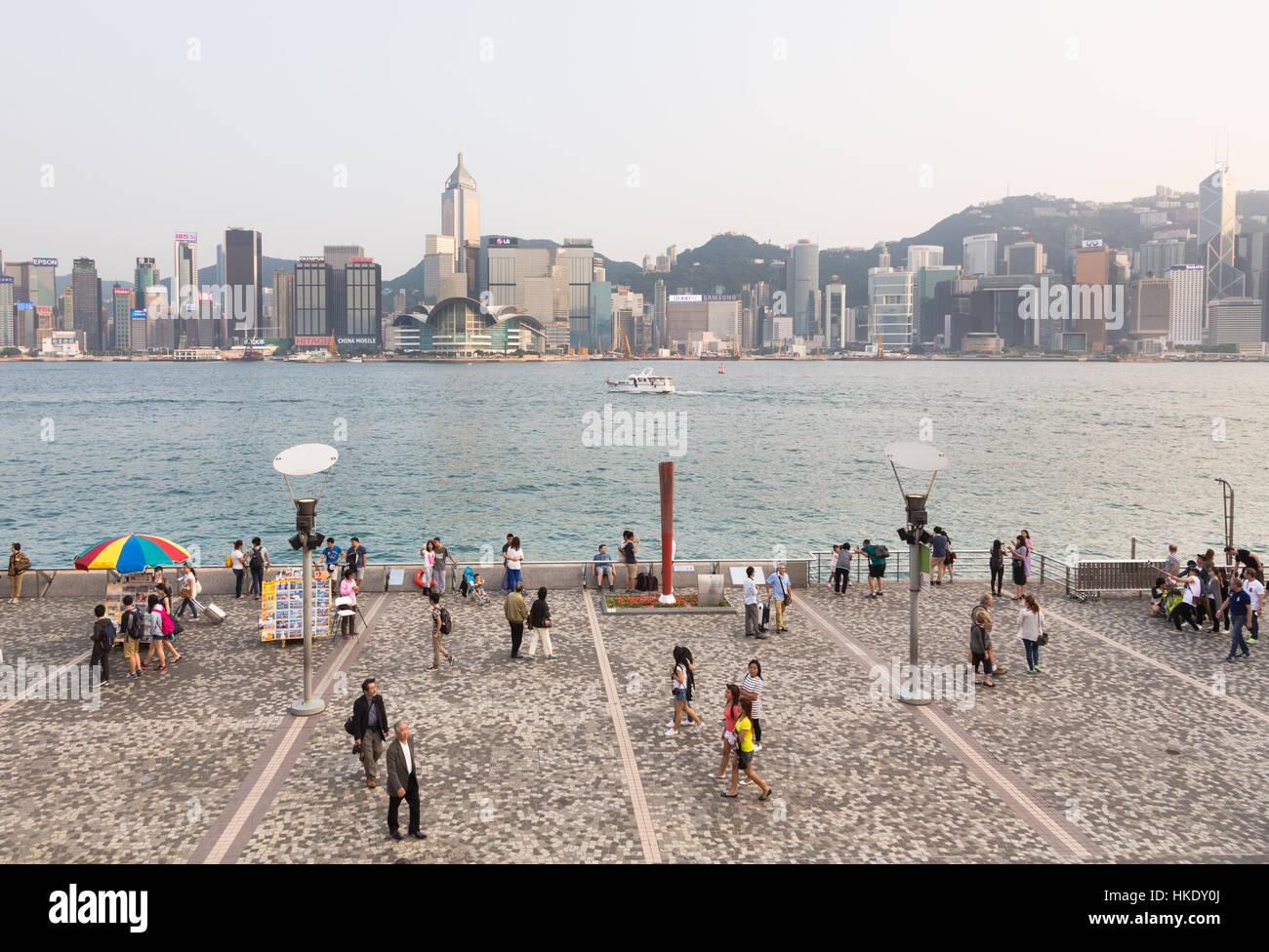 Hong Kong, Hong Kong - April 26 2015: Tourists take pictures and enjoy the famous Hong Kong island skyline across - Stock Image