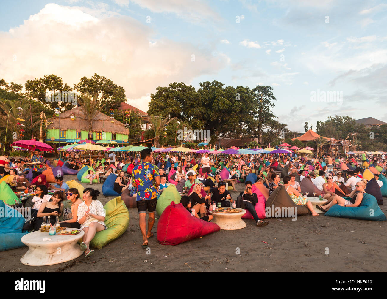 KUTA, INDONESIA - FEBRUARY 19, 2016: A large crowd of tourists, Indonesian and foreigners, enjoy the sunset at a - Stock Image
