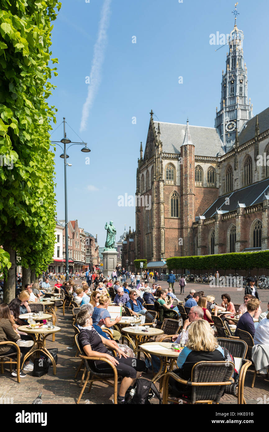 HAARLEM, NETHERLANDS - MAY 27, 2016: People enjoy drinks on a cafe terrace on the Grote Markt square in the center Stock Photo