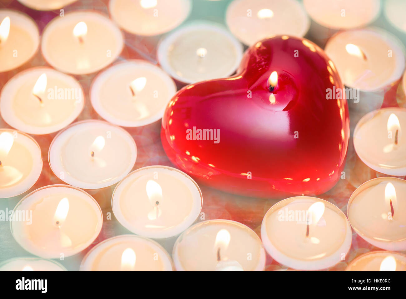 heart with candles - warm up the heart - Stock Image