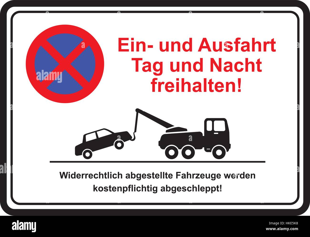 Attention driveway day and night. Unauthorized vehicles will be towed away at owners expense.       Ein- und Ausfahrt - Stock Image