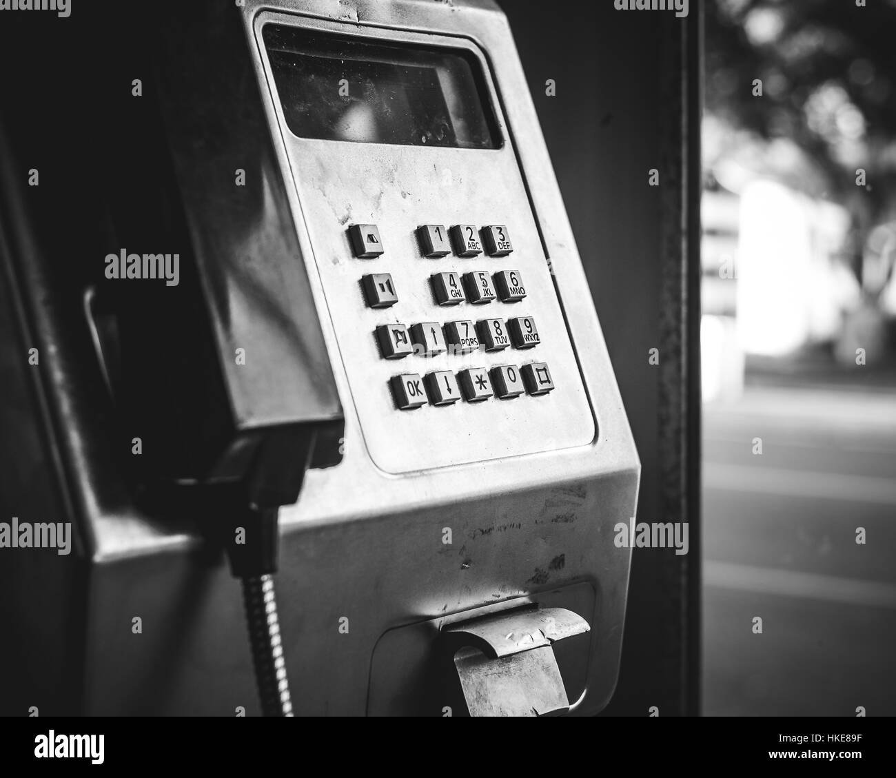 Payphone in phone box black and white - Stock Image