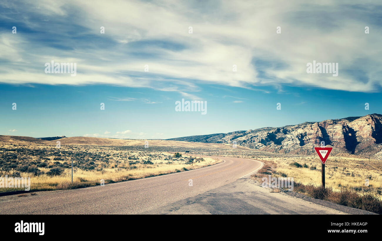 Retro color toned road with yield sign, travel concept picture, USA. - Stock Image