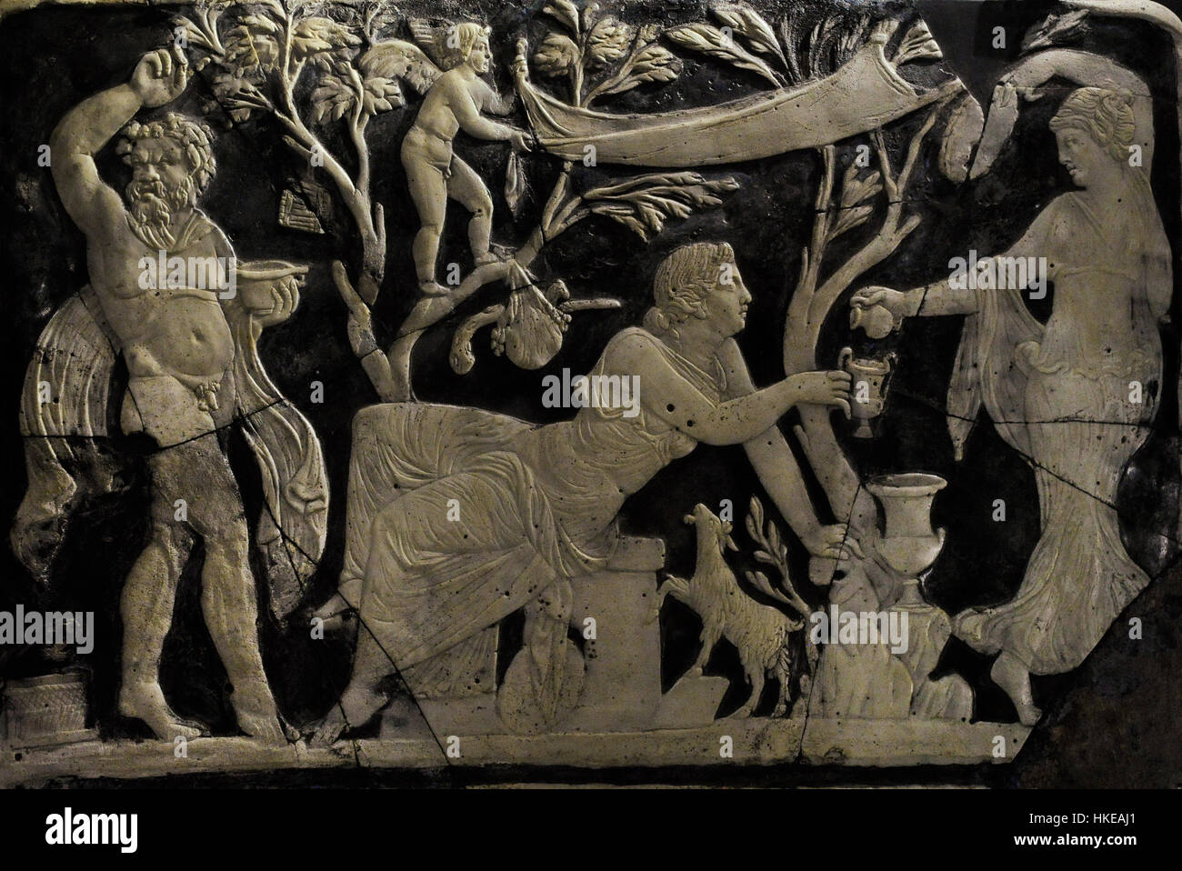 Panel with Maenad pouring wine for Ariadne. Next, a Satyr dancing between trees with objects of the cult of Dionysus. Stock Photo