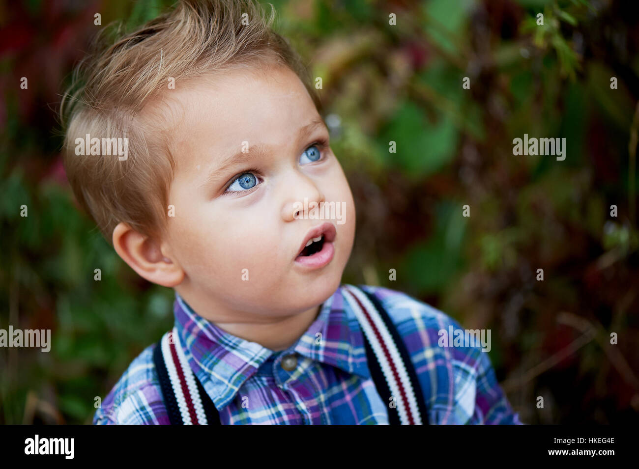 589820a02 Portrait of cute little boy with big blue eyes and a stylish Stock ...