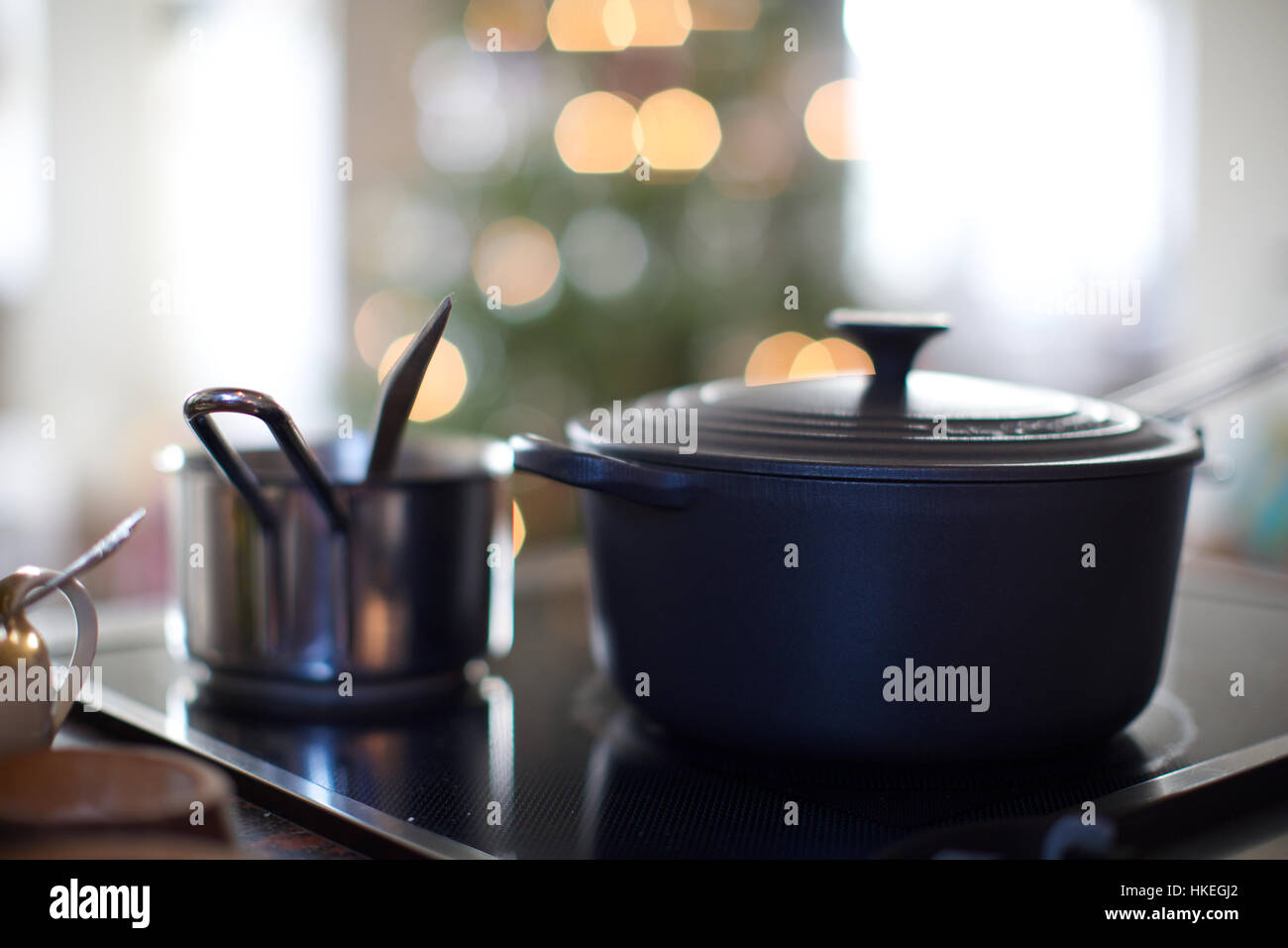 pots and pans on electric induction stove. kitchen, induction cooking, saucepan, lid. - Stock Image