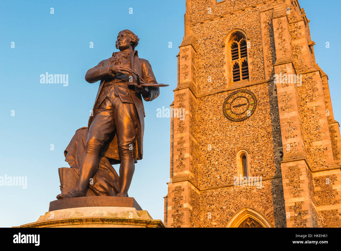 Sudbury Suffolk, statue of artist Thomas Gainsborough and tower of St Peter's Church, Market Hill, Sudbury, - Stock Image