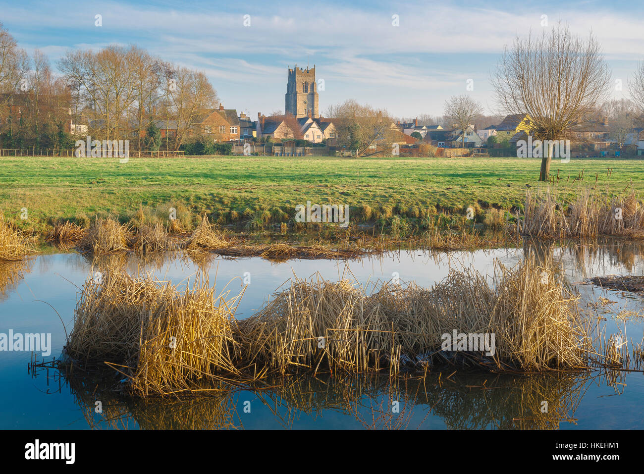 Suffolk landscape, a stretch of the River Stour in winter with the Suffolk town of Sudbury in the distance, Babergh - Stock Image