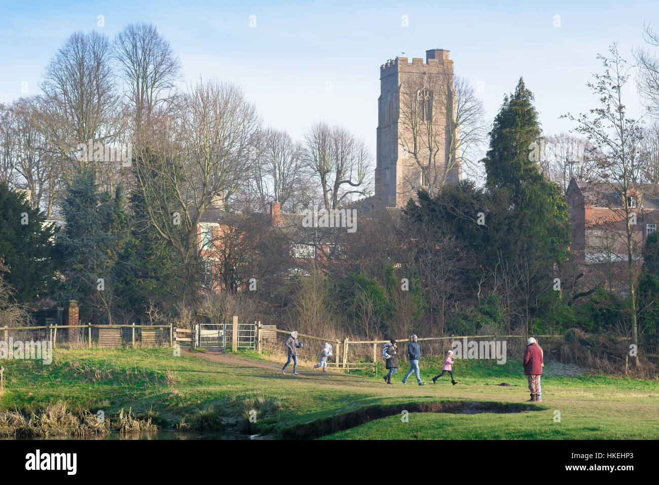 Sudbury Suffolk, people walk through the water meadows in the Suffolk town of Sudbury on a winter afternoon, UK. - Stock Image
