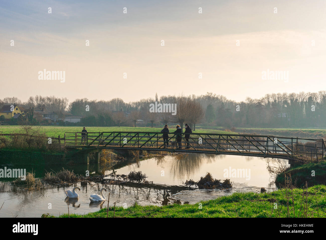Sudbury Suffolk, people chat on a bridge over the River Stour in the water meadows at Sudbury in Suffolk, Babergh - Stock Image