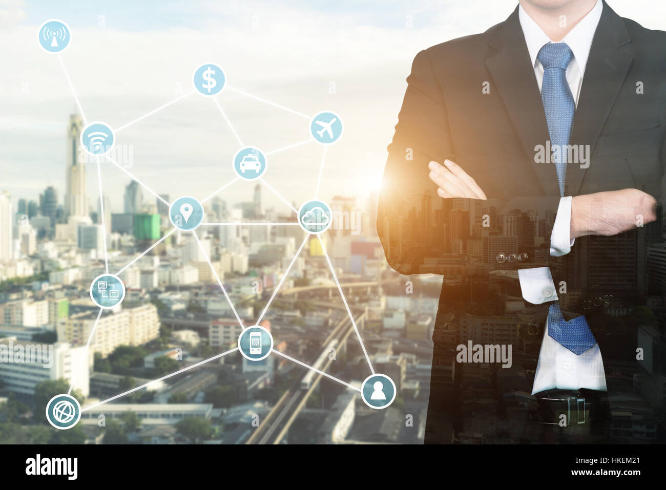 Double exposure businessman standing with his arms crossed with technology and communication icon. - Stock Image